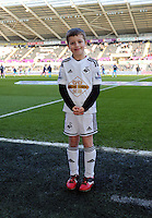 SWANSEA, WALES - FEBRUARY 07: Children mascots before the Premier League match between Swansea City and Sunderland AFC at Liberty Stadium on February 7, 2015 in Swansea, Wales.
