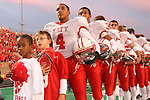 The Katy Tigers await the national anthem prior to the game against JE Taylor High School October 6, 2007.