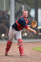 GCL Red Sox catcher Simon Gravel (15) throws to first during a game against the GCL Rays on June 24, 2014 at Charlotte Sports Park in Port Charlotte, Florida.  GCL Red Sox defeated the GCL Rays 5-3.  (Mike Janes/Four Seam Images)