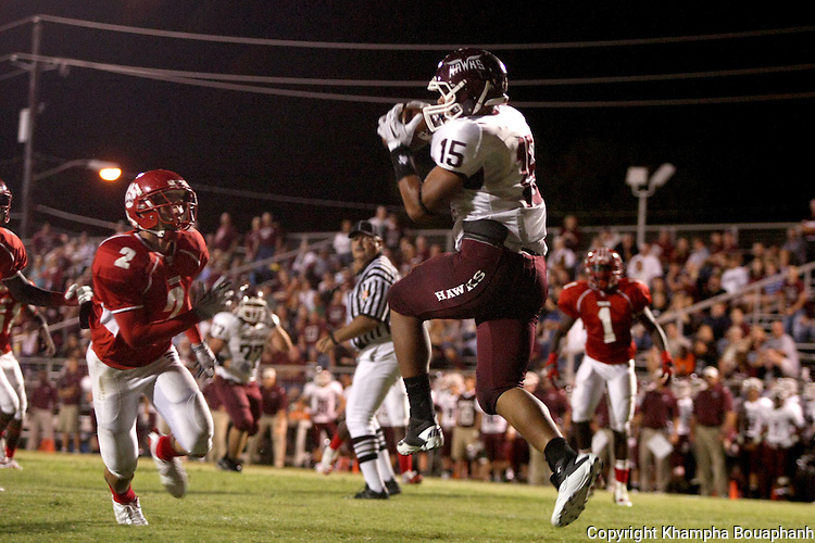 Red Oak's senior tightend Mandel Dixon (15) makes a touchdown reception over Terrell's senior linebacker Preston Paulson (2) during their high school football game in Terrell on October 1, 2010.  (photo by Khampha Bouaphanh)