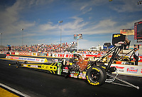 Mar. 30, 2012; Las Vegas, NV, USA: NHRA top fuel dragster driver Morgan Lucas during qualifying for the Summitracing.com Nationals at The Strip in Las Vegas. Mandatory Credit: Mark J. Rebilas-US PRESSWIRE