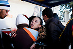 Tunis, Tunisia. January 28th 2011.A woman collapsed because the Police tear gas....