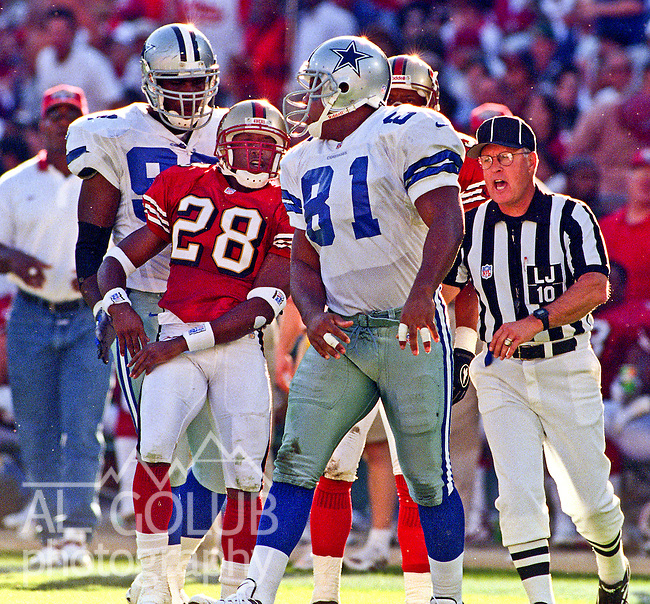 San Francisco 49ers vs. Dallas Cowboys at Candlestick Park Sunday, November 2, 1997.  49ers beat Cowboys  17-10.  San Francisco 49ers defensive back Chris Buckley (28) expresses differences with Dallas Cowboys tight end Scott Galbraith (81).