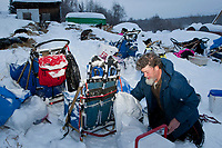 Eric Rogers gets his dog food ready during his 24 hour layover at Takotna during Iditarod 2009