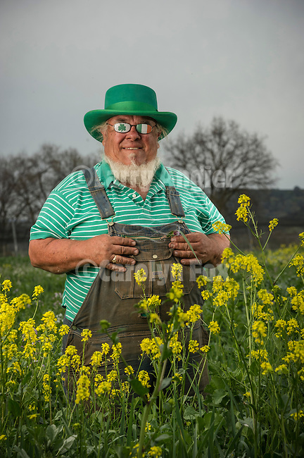 Bob Lockhart out standing in his field near the small rural Amador County community of Buena Vista, Calif.