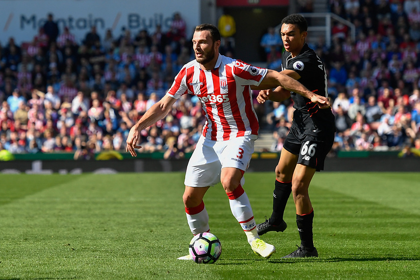 Stoke City's Erik Pieters under pressure from Liverpool's Trent Alexander-Arnold<br /> <br /> Photographer Terry Donnelly/CameraSport<br /> <br /> The Premier League - Stoke City v Liverpool - Saturday 8th April 2017 - bet365 Stadium - Stoke-on-Trent<br /> <br /> World Copyright &copy; 2017 CameraSport. All rights reserved. 43 Linden Ave. Countesthorpe. Leicester. England. LE8 5PG - Tel: +44 (0) 116 277 4147 - admin@camerasport.com - www.camerasport.com