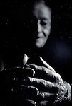 close-up of elderly man's clasped hands