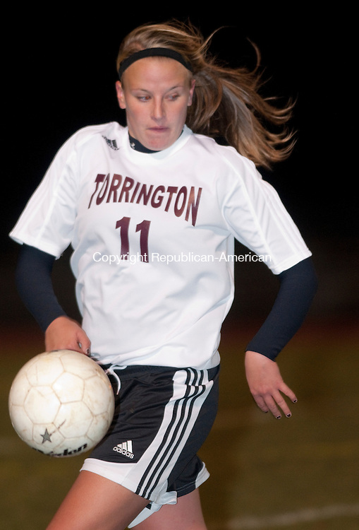 TORRINGTON, CT, 11 NOVEMBER 2010-111110JS01-Torrington's Morgan Thulin (11) gets control of the ball during their 4-2 loss to Masuk in the Class L state tournament game Thursday at Torrington High School. <br />  Jim Shannon Republican-American