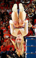 A Virginia cheerleader gets heels over head in a time out during an ACC basketball game Jan. 13, 2015 in Charlottesville, VA Virginia won 65-42.