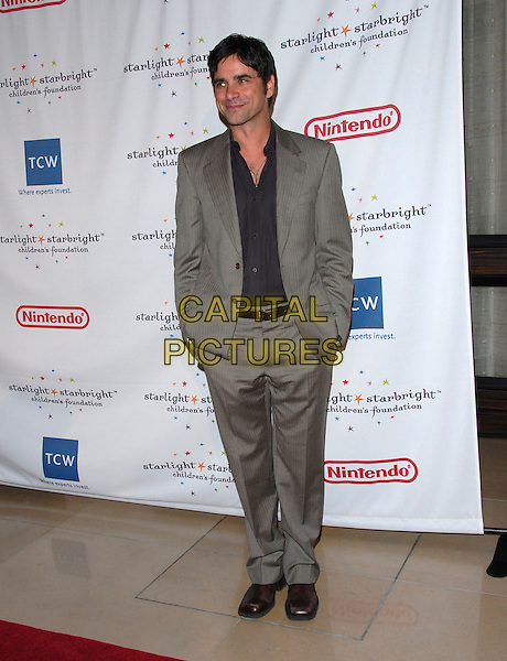 JOHN STAMOS.attends Starlight Starbright Children's Foundation Stellar Night Gala held at The Beverly Hilton Hotel in Beverly Hills, California, USA on March 31st 2006..full length.www.capitalpictures.com.sales@capitalpictures.com.©Debbie Van Story/Capital Pictures