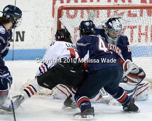 Rachel Llanes (NU - 11), Jody Sydor (UConn - 4), Alexandra Garcia (UConn - 83) - The University of Connecticut Huskies defeated the Northeastern University Huskies 4-1 in Hockey East quarterfinal play on Saturday, February 27, 2010, at Matthews Arena in Boston, Massachusetts.