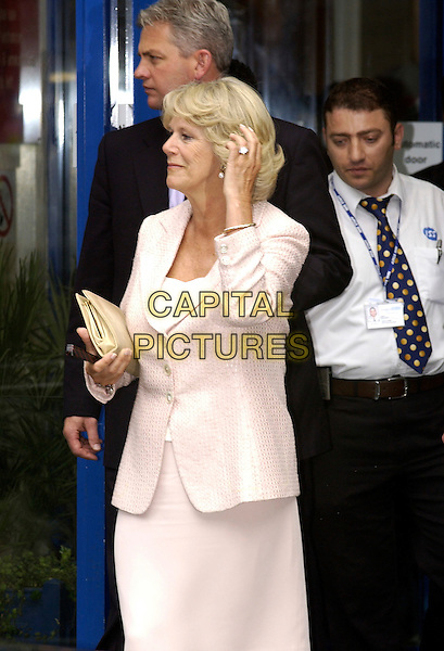 CAMILLA, DUCHESS OF CORNWALL  .Visiting St.Mary's Hospital in Paddington, London..July 8th 2005..half length royal pink dress suit touching hair.www.capitalpictures.com.sales@capitalpictures.com.© Capital Pictures.
