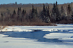 Snow Scene, Canada, showing frozen river, ice