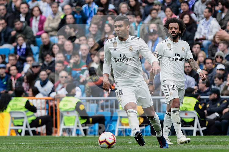 Real Madrid's Carlos Henrique Casemiro (L) and Marcelo Vieira (R) during La Liga match between Real Madrid and Athletic Club de Bilbao at Santiago Bernabeu Stadium in Madrid, Spain. April 21, 2019. (ALTERPHOTOS/A. Perez Meca)