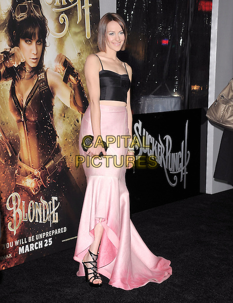 "JENA MALONE .at The Warner Bros. Pictures World Premiere of ""Sucker Punch"" held at The Grauman's Chinese Theatre in Hollywood, California, USA,.March 23rd 2011..full length pink skirt clutch bag long maxi  bracelets black straps train midriff crop top sandals open toe .CAP/RKE/DVS.©DVS/RockinExposures/Capital Pictures."
