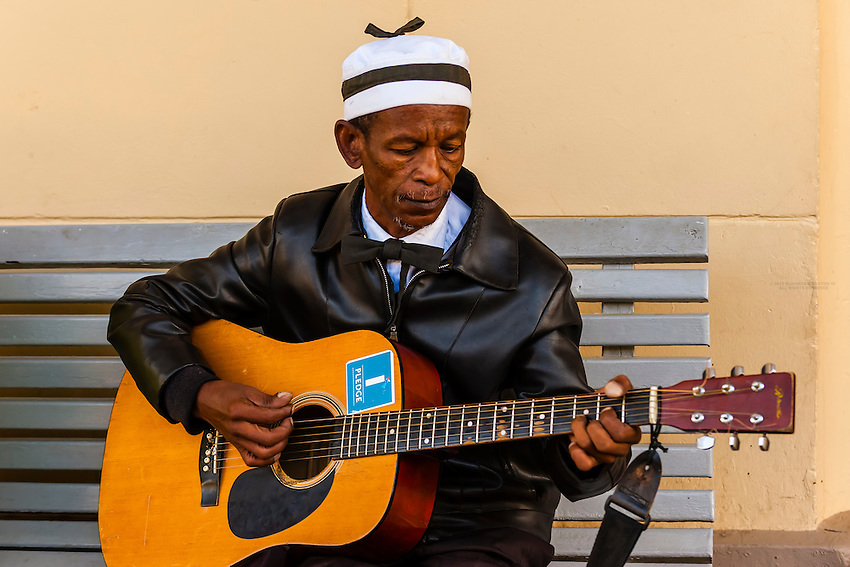 "A local man plays guitar at the train station at Matjiesfontein, Rovos Rail train ""Pride of Africa"" on it's journey between Pretoria and Cape Town, South Africa."