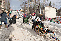 Becca Moore and team run past spectators on the bike/ski trail with an Iditarider in the basket during the Anchorage, Alaska ceremonial start on Saturday, March 5, 2016 Iditarod Race. Photo by O'Hara Shipe/SchultzPhoto.com