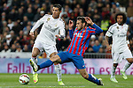 Real Madrid´s Cristiano Ronaldo (L) and Levante´s Ivan Lopez during La Liga match at Santiago Bernabeu stadium in Madrid, Spain. March 15, 2015. (ALTERPHOTOS/Victor Blanco)