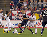 Second half substitute New England Revolution forward Ilica Stojica (9) dribbles in a crowd. The New England Revolution defeated DC United, 1-0, at Gillette Stadium on August 7, 2010.