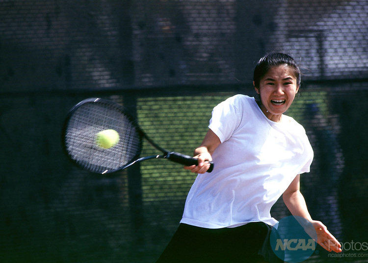Caption: 12 MAY 1997: Rhodes College's Nao Kinoshita slams the ball across the net during the singles championship match of the Division 3 Women's Tennis Championship held at Claremont University in Claremont, CA. Kinoshita defeated Jamie Levine of Skidmore 6-4, 6-4 for the singles championship title. Hans Gutknecht/NCAA Photos.