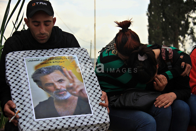 Palestinian Students of Jenin's Freedom Theater weep while waiting for the body of Arab-Israeli actor and director Juliano Mer-Khamis during his funeral at al Jalama Israeli checkpoint between Hayfa City and the West Bank city of Jenin on 6 April 2011. Mer-Khamis, 52-year-old director of The Freedom Theatre in Jenin, was shot dead on 4 April by unknown gunmen in Jenin, Palestinian police and medics said.Photo by Wagdi Eshtayah