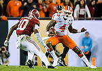 Clemson quarterback Deshaun Watson tries to get past Alabama linebacker Reuben Foster in the second half of the 2017 College Football Playoff National Championship in Tampa, Florida on January 9, 2017.  Clemson defeated Alabama 35-31. Photo by Mark Wallheiser/UPI