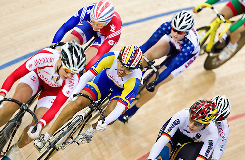 19 FEB 2012 - LONDON, GBR - Venezuela's Daniela Larreal (VEN) (centre in blue, yellow and white) competes during her Women's Keirin first round race at the UCI Track Cycling World Cup, and London Prepares test event for the 2012 Olympic Games, in the Olympic Park Velodrome in Stratford, London, Great Britain .(PHOTO (C) 2012 NIGEL FARROW)
