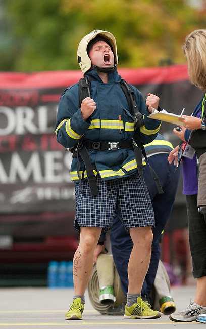 Vancouver, Canada, Aug 6th 2009.  World Police and Fire Games, Ultimate Firefighter Competition. Competitor Jan Seps from the Varnsdorf Fire Service, Czech Republic, is pleased with his performance in the hose task portion of the competition. In this stage, competitors must drag two 150-foot long 2 ½-inch fire hoses their full length plus 30 feet, and then move to another station and roll up two 50-foot sections of hose and carry them back to the finish line.  Photo by Gus Curtis