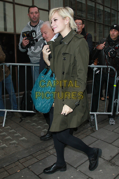 Pixie Lott leaving the studios of BBC Radio 1, London, England..November 8th, 2011.full length green coat jacket mac black tights teal bag purse side .CAP/HIL.©John Hillcoat/Capital Pictures .