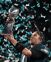 Quarterback Nick Foles of Philadelphia Eagles lifts the Vince Lombardi Trophy.<br /> New England Patriots v Philadelphia Eagles, Super Bowl LII, US Bank Stadium, Minnesota,USA