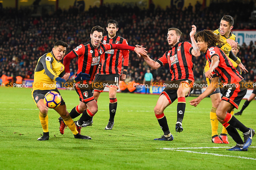 Alexis Sanchez of Arsenal left is crowded out by four AFC Bournemouth defenders during AFC Bournemouth vs Arsenal, Premier League Football at the Vitality Stadium on 3rd January 2017