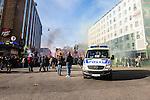 Stockholm 2014-04-16 Fotboll Allsvenskan Djurg&aring;rdens IF - AIK :  <br /> Polisbil framf&ouml;r AIK supportrar innan marschen p&aring; G&ouml;tgatan fr&aring;n Medborgarplatsen till Tele2 Arena inf&ouml;r derbyt mellan Djurg&aring;rden och AIK<br /> (Foto: Kenta J&ouml;nsson) Nyckelord:  Djurg&aring;rden DIF Tele2 Arena AIK supporter fans publik supporters