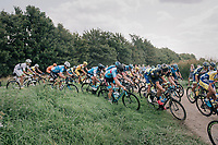 "peloton trying a short-cut<br /> <br /> Antwerp Port Epic 2018 (formerly ""Schaal Sels"")<br /> One Day Race:  Antwerp > Antwerp (207 km; of which 32km are cobbles & 30km is gravel/off-road!)"
