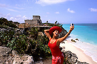 Colorful Hispanic Tourist with camera at Tulum Ruins at Riviera Maya Mexic