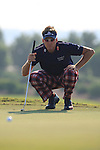 Ian Poulter eyes up his putt on the 12th green during the third round of the Dubai World Championship on the Earth Course at the Jumeirah Golf Estate, Dubai..Picture Fran Caffrey/www.golffile.ie.