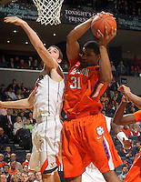 Feb. 2, 2011; Charlottesville, VA, USA; Clemson Tigers forward/center Devin Booker (31) grabs a rebound in front of Virginia Cavaliers guard Joe Harris (12) during the game at the John Paul Jones Arena. Mandatory Credit: Andrew Shurtleff