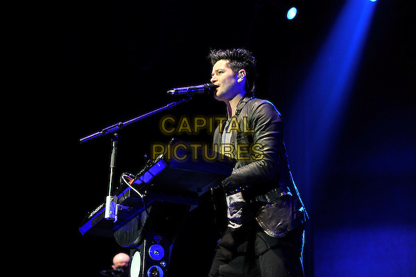 THE SCRIPT - Danny O'Donoghue.Performing live at the O2 Arena, London, England, UK, March 26th 2011..half length concert music gig  on stage playing keyboard microphone singing .CAP/MAR.© Martin Harris/Capital Pictures.