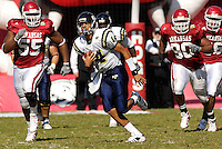 Florida International University Golden Panthers versus the University of Arkansas Razorbacks at Donald W. Reynolds Razorback Stadium, Fayetteville, Arkansas on Saturday, October 27, 2007.  The Razorbacks defeated the Golden Panthers, 58-10...FIU sophomore quarterback Wayne Younger (14) (Cocoa, Fla.) runs against Arkansas in the second quarter.