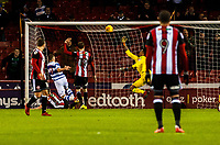 Sheffield United's goalkeeper Jamal Blackman (27) tips over from Queens Park Rangers forward Conor Washington (9) during the Sky Bet Championship match between Sheff United and Queens Park Rangers at Bramall Lane, Sheffield, England on 20 February 2018. Photo by Stephen Buckley / PRiME Media Images.