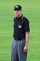 Base umpire Patrick Sharshel during the game against the Ogden Raptors and the Great Falls Voyagers in Pioneer League play at Lindquist Field on August 16, 2013 in Ogden Utah.  (Stephen Smith/Four Seam Images)