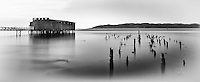 An abandoned warehouse and pilings on the Columbia River are a reminder of Astoria's history as a first stop for fishing boats returning from the Pacific.