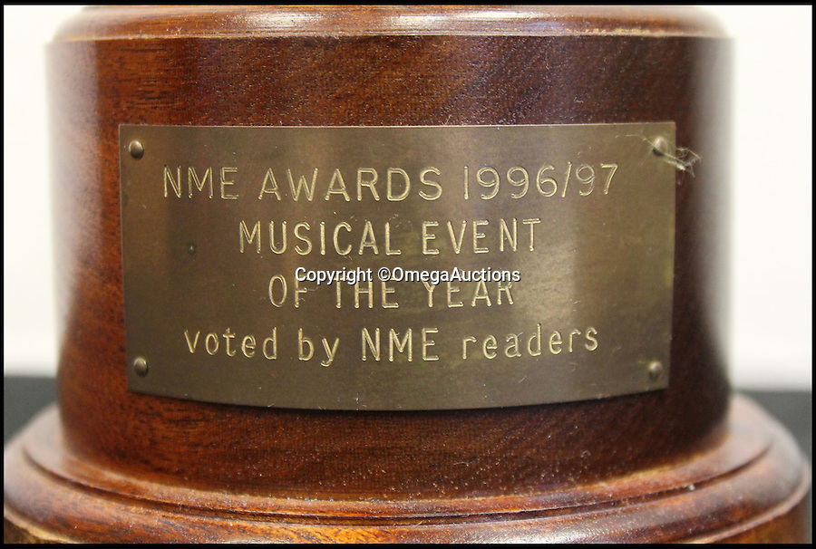 BNPS.co.uk (01202 558833)<br /> Pic: OmegaAuctions/BNPS<br /> <br /> A disfigured NME award Noel Gallagher smashed in anger at the lack of compassion shone to a fellow rocker who lost his life has emerged for auction.<br /> <br /> When the Oasis legend took to the stage 20 years ago to pick up the NME award for 'The Musical Event of the Year' for their mega concerts at Knebworth in August 1996, he was in no mood to celebrate.<br /> <br /> Instead, he vented his fury at the then NME editor Steve Sutherland for not acknowledging the death of The Charlatans keyboard player Rob Collins in the publication.<br /> <br /> The award - which the manager kept hold of for 20 years but has now decided to off-load - is valued at £4,000.