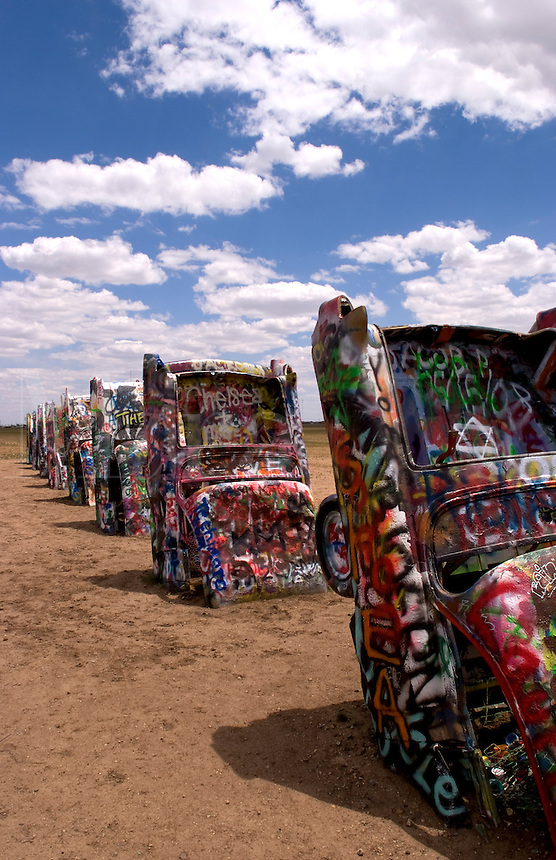 The Cadillac Ranch with buried cars in ground in Amarillo Texas USA