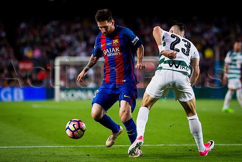 May 21st 2017, Nou Camp, Barcelona, Spain; La Liga football, FC Barcelona versus Eibar; Leo Messi of FC Barcelona fight the ball against Eibar defender Juncà