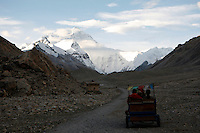 China started building a controversial 67-mile &quot;paved highway fenced with undulating guardrails&quot; to Mount Qomolangma, known in the west as Mount Everest, to help facilitate next year's Olympic Games torch relay./// Chinese tourists take a pony cart to Everest Base Camp.<br /> Tibet, China<br /> July, 2007
