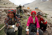 China started building a controversial 67-mile &quot;paved highway fenced with undulating guardrails&quot; to Mount Qomolangma, known in the west as Mount Everest, to help facilitate next year's Olympic Games torch relay./// Tibetan women take a rest while working on the road to EBC. <br /> Tibet, China<br /> July, 2007
