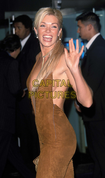 NELL MCANDREW..Spiderman film premiere at Odeon, Leicester Square...ref : 11729..suede catsuit, halterneck, hair extensions..sales@capitalpictures.com..www.capitalpictures.com..