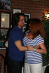 One Life To Live's Michael Easton is surprised by costar Melissa Archer on July 13, 2008 at Uncle Vinnie's Comedy Club in Point Pleasant, New Jersey. There was entertainment, q & a, and signing of photos and Michael's new book, a  graphic novel (which Melissa is holding) written by Michael and artwork by Christopher Shy. (Photo by Sue Coflin/Max Photos)