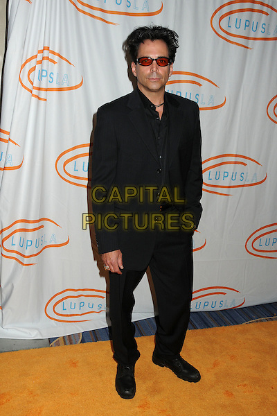 Richard Grieco.12th Annual Lupus LA Orange Ball held at the Beverly Wilshire Hotel, Beverly Hills, California, USA..May 24th, 2012.full length suit red tinted glasses sunglasses shades black.CAP/ADM/BP.©Byron Purvis/AdMedia/Capital Pictures.
