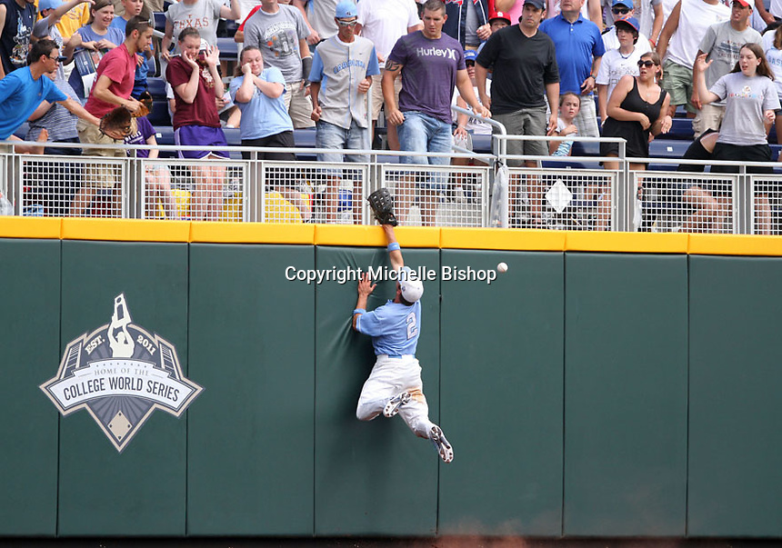 North Carolina's Chaz Frank (2) can't get to a ball hit off the top of the wall by Vanderbilt's Conrad Gregor during the sixth inning. Vanderbilt won 7-3 to open the 2011 College World Series in Omaha, Neb. (Photo by Michelle Bishop)..